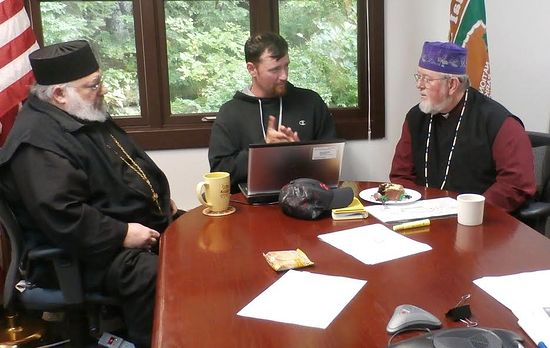 Dr. Urban explains his initial findings to Fr. Michael Boyle of St. Michael Cathedral and Bishop David.
