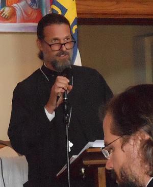 Fr. Josiah Trenham emceeing the St. Sebastian symposium
