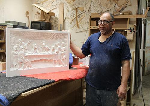 Carlo Ramos Martes displays a recent piece.