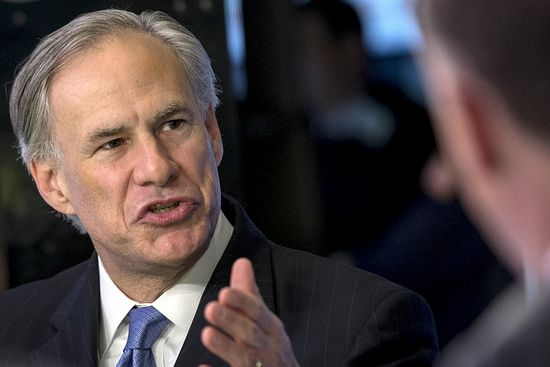 Texas governor Greg Abbott speaks during an interview on the floor of the New York Stock Exchange July 14, 2015.