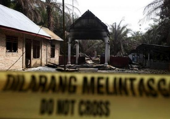 Police tape restricts access to a burned church at Suka Makmur Village in Aceh Singkil, Indonesia Aceh province, October 18, 2015.