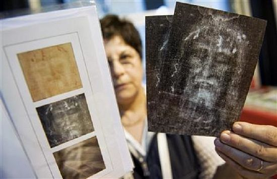 A woman shows souvenirs of the Holy Shroud at the official bookstore during the first day of its exhibition in Turin April 10, 2010.