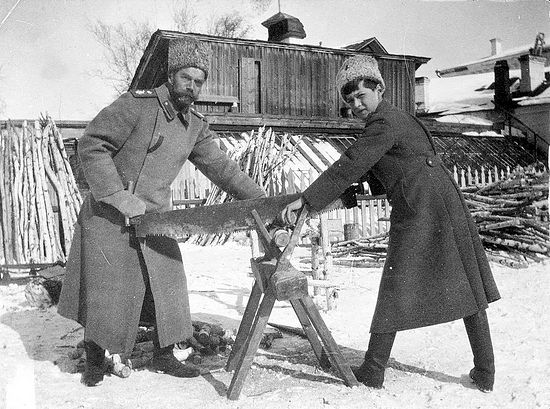 Emperor Nicholas II sawing wood with Alexei during the Imperial Family's winter at Tobolsk.