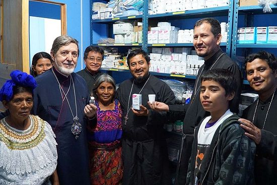 His Eminence, Metropolitan Athenagoras, stands in the pharmacy of the Aguacate Clinic
