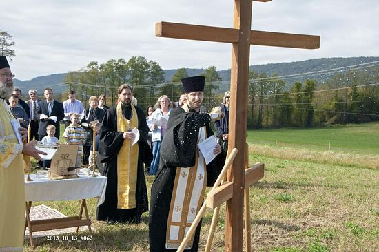 Fr. Timothy blessing the Cross erected at the site of the new church.