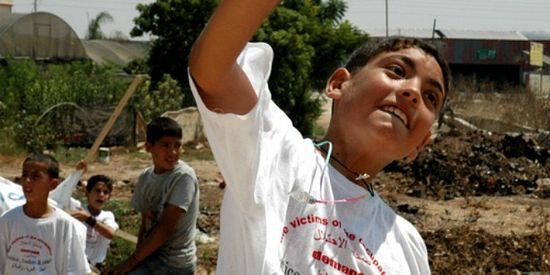 "ILLUSTRATIVE – Arab youth taught to throw rocks and swing sticks. Their t-shirts read ""victims of the occupation."" Because rocks attacks have killed many civilians, the government is cracking down. (Photo: Justin McIntosh) Read more at https://www.breakingisraelnews.com/54447/russia-become-active-education-palestinian-youth-judea-and-samaria/#6QHCPROOgtW0rjh8.99"