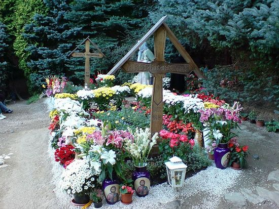 The grave of St. Arsenie Boca, surrounded by multi-colored and fragrant flowers that blossom year-round.