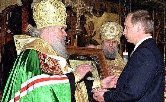 Inside the Dormition Cathedral (Uspenskiy Sobor) in the Kremlin, the Patriarch presents new Russian president Vladimir Putin with an icon of St. Alexander Nevsky at the latter's presidential inauguration, 7 May 2000.
