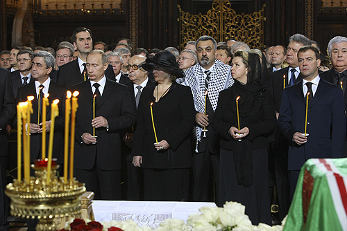 From left: Russian President Vladimir Putin, his then-wife Ludmila Putina, Svetlana Medvedeva, and Prime Minister Dmitry Medvedev at Aleksey II's funeral liturgy in Christ the Saviour Cathedral, Moscow.