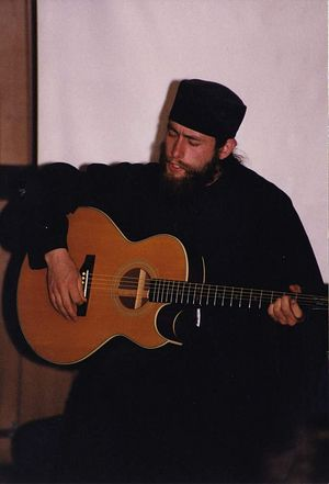 Marler plays guitar at an Eastern Orthodox monastery on a remote island in Alaska in 1996. The monastery was a satellite location of St. Herman Monastery in Platina, Calif., where Marler began his monastic training. (Courtesy of Justin Marler)