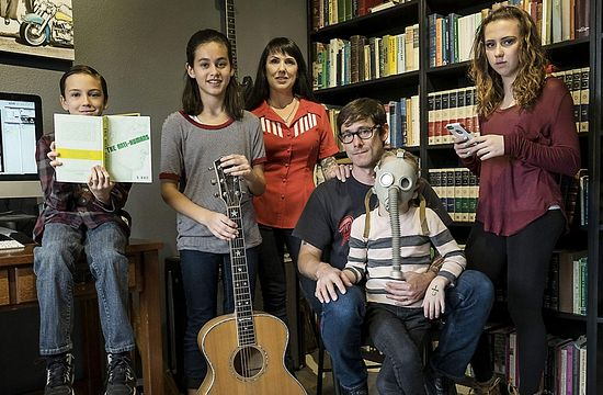Marler and family pose for a portrait in their home. From left, Ethan Bennett, 9, Laura Marler, 11, wife Nova Marler, Sophia Marler (wearing a gas mask prop from a 'Hymns for the Apocalypse' music video), 8, and Hannah Bennett, 16. (Rodolfo Gonzalez/American-Statesman)