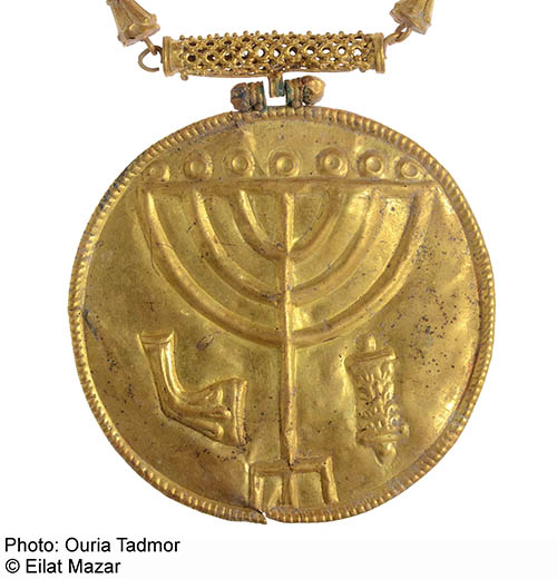 The prize find of the so-called Ophel treasure unearthed in the Ophel excavations is a gold medallion featuring a menorah, shofar (ram's horn) and a Torah scroll. Photo: Courtesy of Dr. Eilat Mazar; photo by Ouria Tadmor.
