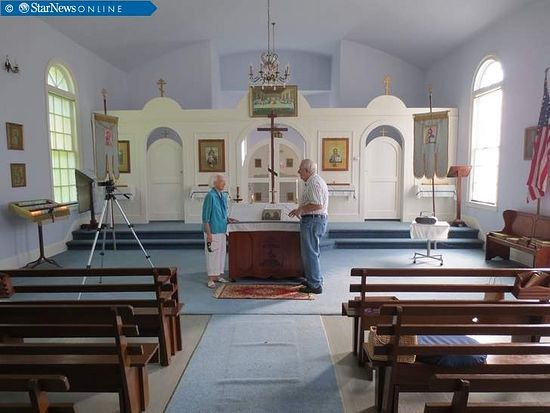 Contributed photo of Mike Raab talks with Ann Mizerak inside St. Helena's St. Peter and Paul Russian Orthodox Church. Mizerak is one of just three members of the historic church. COURTESY OF MIKE RAAB