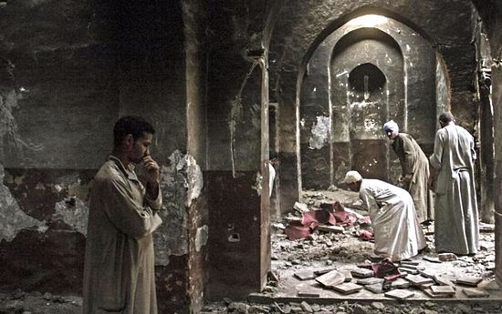 Egyptian Christian villagers cleaned up the damaged ancient chapel inside the Virgin Mary and St. Abraam Monastery that was looted and burned by Islamists in Dalga, Minya province, Egypt, in 2013. It was part of a wave of attacks in the southern Minya province that targeted Christians, their homes, and their businesses. (AP Photo/El Shorouk Newspaper, Roger Anis)