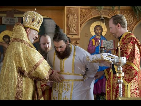 His Eminence Metropolitan Joseph Al-Zehlaoui, the archbishop of the Antiochian Orthodox Christian Archdiocese of North America, assists new priest, Rev. Father John Mahfouz, with his vestments at Saints Peter and Paul Antiochian Orthodox Church in Salt Lake City Sunday, Dec. 13, 2015. (Photo: Scott G Winterton, Deseret News)