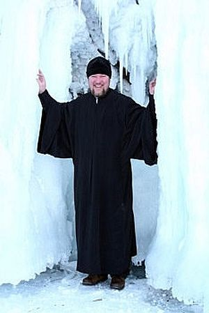 Priest Igor Zyryanov at icebound Lake Baikal