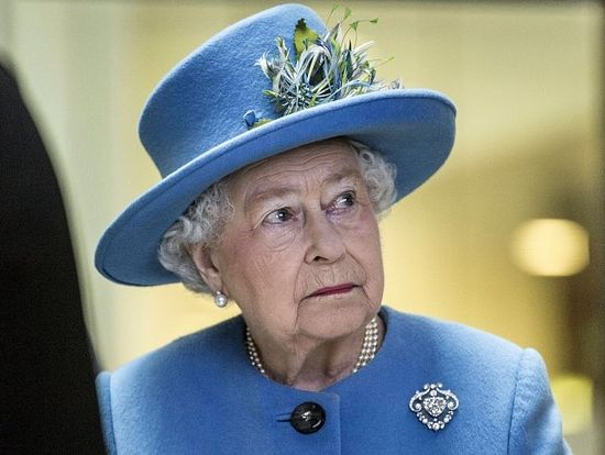 Queen Elizabeth listening to speeches by others at the Home Office last month.