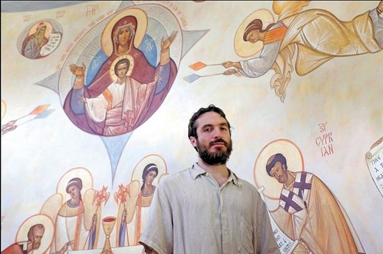 """Seraphim is an iconographer, and the icons he is painting aren't supposed to express a private vision or even offer realistic likenesses of the individual saints he depicts. """"Icons are images that help us in worship,"""" he says. """"They are to glorify God. We are to look through them to glimpse God in his glory."""" (Photo by Jay Paul)"""