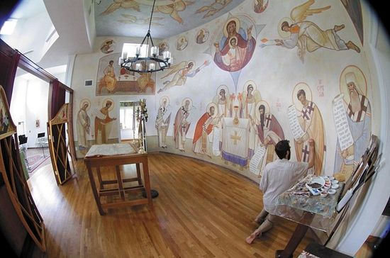 """""""I'd like to paint one of the murals that are appearing around town,"""" Seraphim says. """"I'd like to bring more of a spiritual sensibility to them. That would be great."""" (Photo by Jay Paul)"""