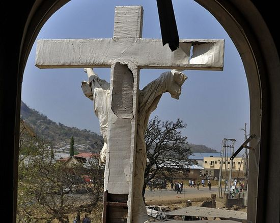 A damaged crucifix overlooks the scene of a bomb explosion at St. Theresa Catholic Church at Madalla, Suleja, just outside Nigeria's capital Abuja, December 25, 2011. Five bombs exploded on Christmas Day at churches in Nigeria.