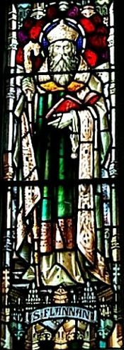 A stained glass window of St. Flannan