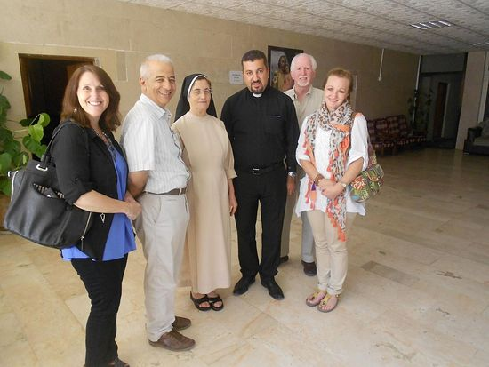 Providing medicine to clinic at St. Josephs Chaldean Catholic Church, Suleimai, Iraq.