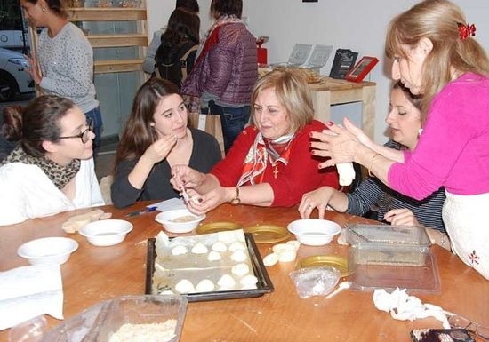 Baking cookies with the women of the Rameh Orthodox Christian Church.. (photo credit:MEDIA LINE)