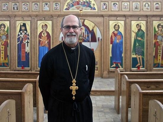 Father David Kruse poses for a photograph in the sanctuary of St. Raphael Orthodox Christian Church on Wednesday, Dec. 2, 2015. Located in Thousand Palms, the church was founded by a family of Syrian refugees. (Photo: Lucas Esposito/The Desert Sun)