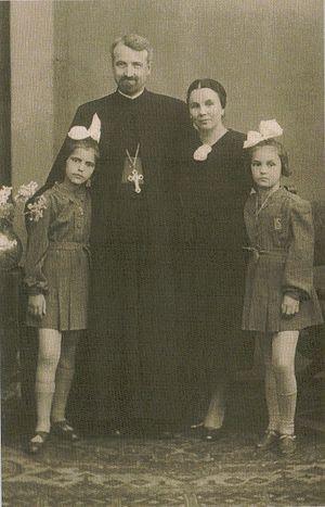О.Думитру с женой и детьми