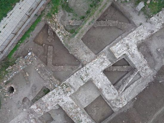 The ruins of a Late Roman stone building destroyed in the barbarian invasions in the 4th century AD are seen underneath the fortress wall and gate built in the 6th century. Photo: Tsarevo Municipality Facebook Page