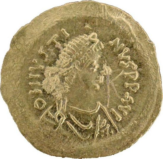 This newly found gold coin of Byzantine Emperor Justine I (r. 518-527 AD) was minted to pay for the construction of the Early Byzantine Fortress in Agathopolis but was never in use, according to the archaeologists. Photo: Tsarevo Municipality Facebook Page