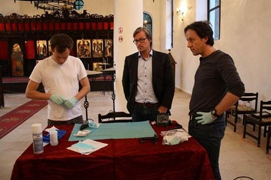 Dr. Hannes Schroeder (left) and Prof. Eske Willerslev (middle) from the University of Copenhagen and Prof. Tom Higham from Oxford University are seen here extracting DNA samples from the relics of St. John the Baptist kept at the St. Cyril and St. Methodius Church in Bulgaria's Sozopol back in 2014. Photo: Prof. Kazimir Popkonstantinov/24 Chasa daily