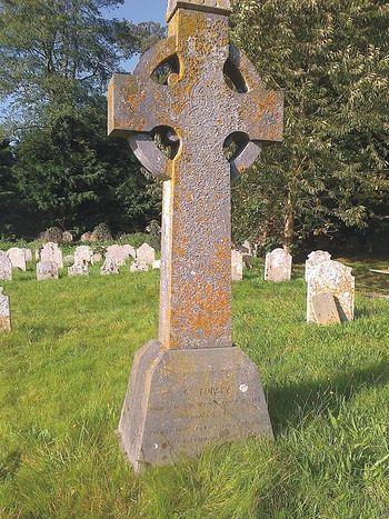 Celtic cross in memory of St. Fursey in churchyard of Burgh Castle church