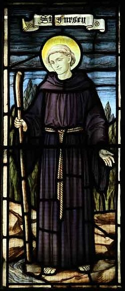 Stained glass image of St. Fursey in a Norwich church
