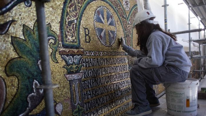 A restoration expert works on a mosaic inside the Church of the Nativity in the West Bank city of Bethlehem on Feb 4, 2016. (AP Photo/Nasser Nasser)