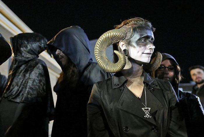 In this 2015 file photo, a Satanic Temple of Seattle member wears horns outside a football game in Bremerton, Wash. (Meegan M. Reid/Kitsap Sun file via AP)