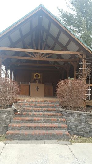 An outdoor chapel frequented by many of the monastery cats