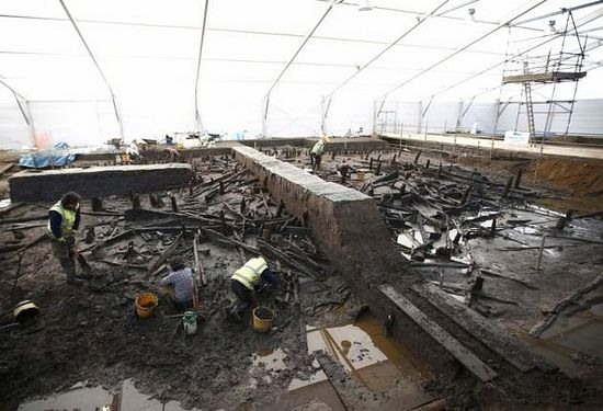 Archaeologists from the University of Cambridge Archaeological Unit, uncover Bronze Age wooden houses, preserved in silt, from a quarry near Peterborough, Britain, January 12, 2016.