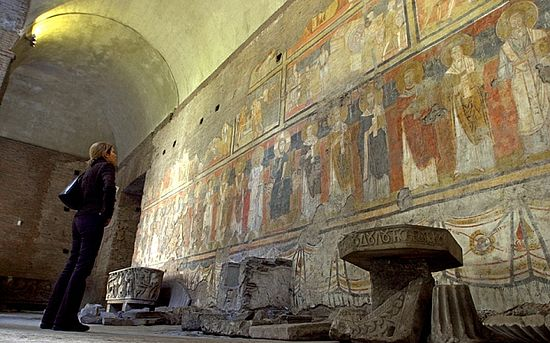 A visitor looks at a fresco, Christ on throne with Saints, believed to date back to 757 A.D., in Santa Maria Antiqua monument Photo: AP