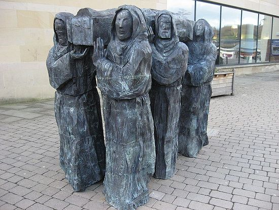 Six monks are carrying the coffin of St. Cuthbert to Durham (a sculpture)