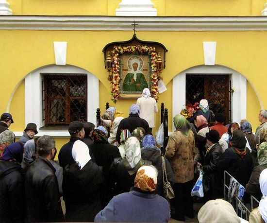 Before an icon of Blessed Matrona of Moscow at the Protection Convent.