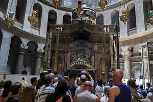 A group of Israelis visit the rotunda in the Church of the Holy Sepulchre. (Jim Hollander/EPA)