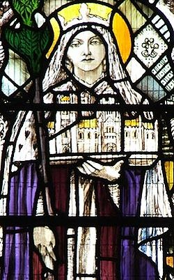 A stained glass window of St. Etheldreda