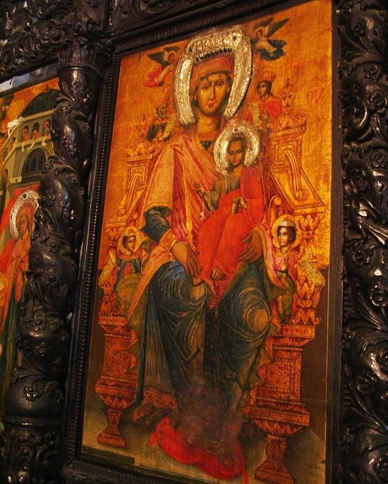 Mary and infant Jesus are one of the paintings decorating the wooden screen.