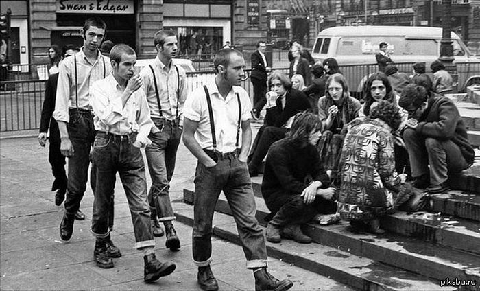 Skinheads and hippies. Piccadilly Circus, London, 1969.