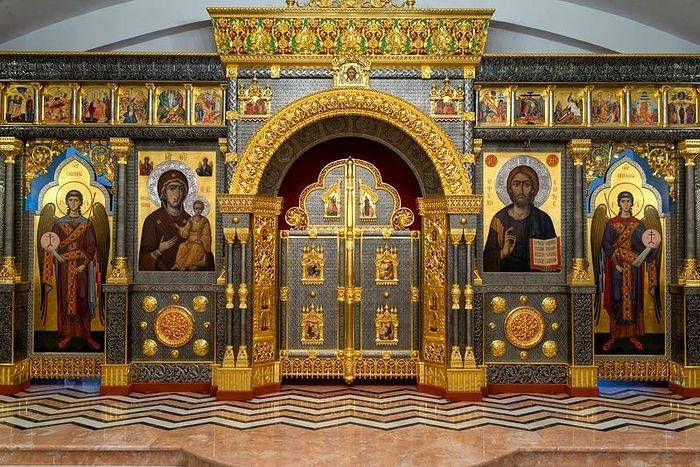 Why must a church have an iconostasis and curtain over the