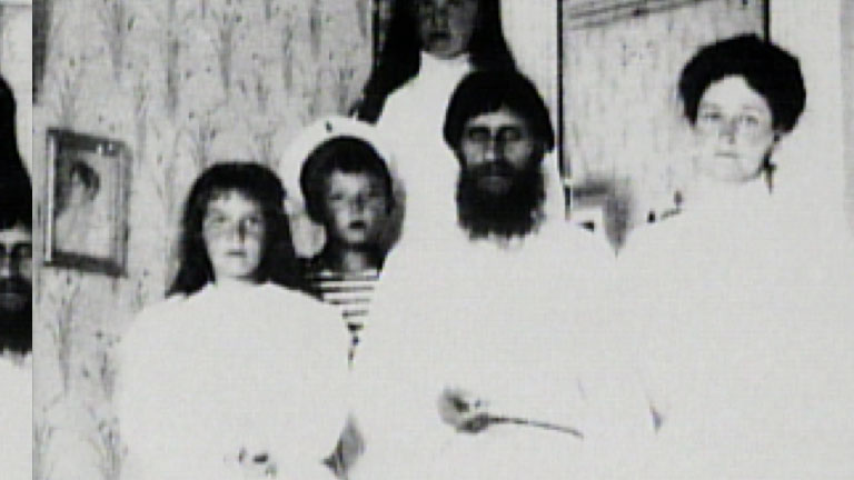 G. Rasputin with the Tsarina Alexandra and children.