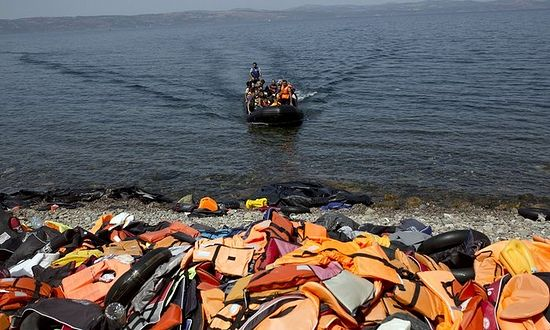 Migrants arriving on Lesbos after crossing the Aegean from Turkey. Photograph: Angelos Tzortzinis/AFP/Getty