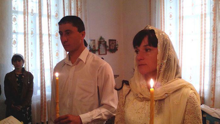 Александр с супругой на венчании