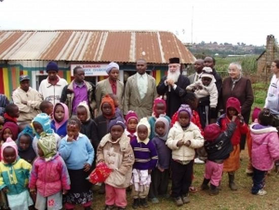 A photo with Archbishop Makarios during his first visit at the Mission Centre